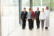 group of businesspeople walking in office building