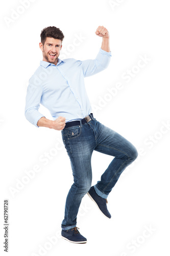 Man with hands clenched in fists in success