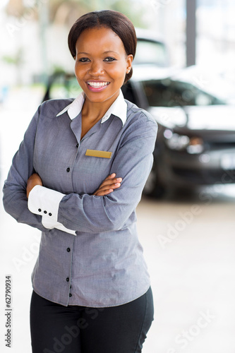african woman working at car dealership