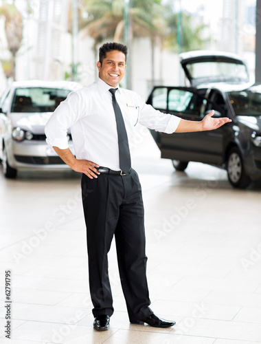 indian car salesman presenting new cars