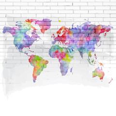 watercolor world map on a brick wall