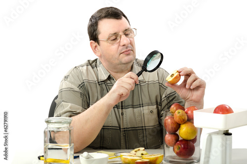 Phytocontrol engineer stares at the rotten apple