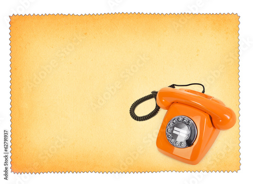 classic bakelite telephone over stained paper