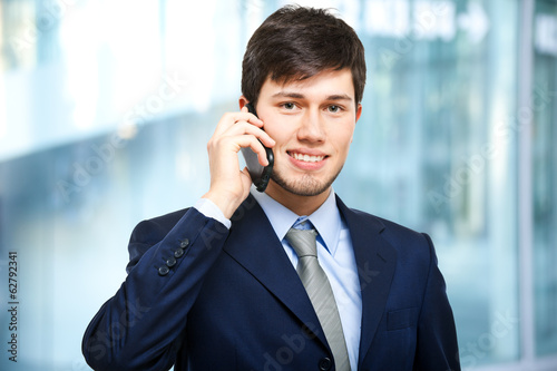 Young businessman talking at the phone