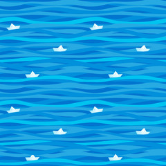 Blue seamless pattern with waves and paper boats.