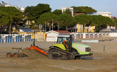 Bulldozer at Work on a Sandy Beach