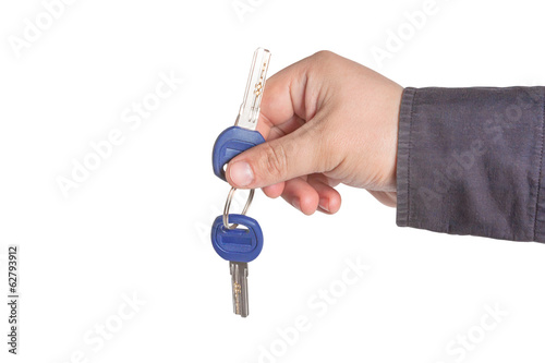 Young man holding keys in hand