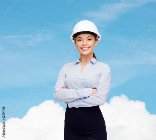 friendly smiling businesswoman in white helmet