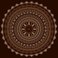 Round ethnic ornament in cappuccino tones