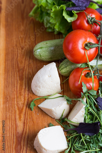 background from mixed vegetables with wood board