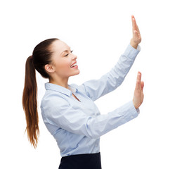 smiling businesswoman pointing to something