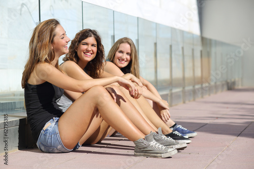 Group of teenager girls talking and laughing happy outdoor