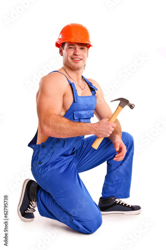 Portrait of sexy mechanic with a hammer