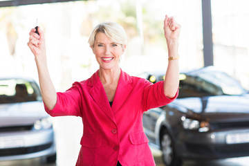 senior woman collecting her new car from dealership