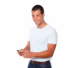 Fashionable man sending a message by mobile