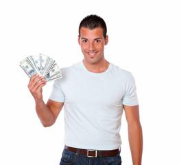 Hispanic guy smiling and holding dollars