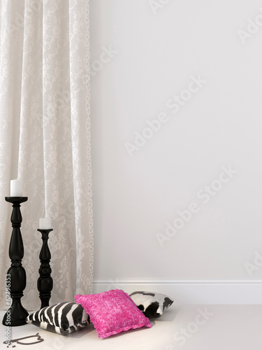Black and white decor against a white curtains