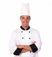Professional hispanic chef smiling at you