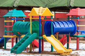 Plastic outdoor kids playground in winter