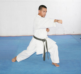 Black belt Man in kimono during training karate kata exercises i