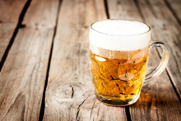 Beer mug on vintage rustic wood table - pub menu