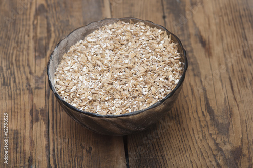Pale malt barley in a glass bowl, an ingredient for beer.