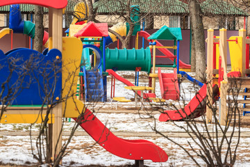 outdoor kids playground in winter city in sunny day