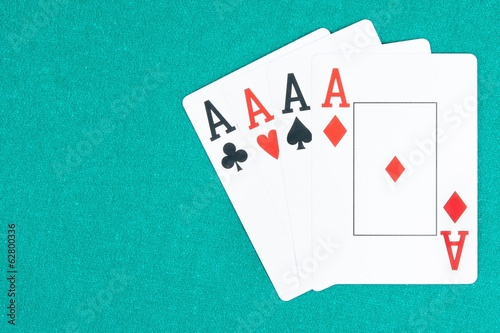 poker aces cards on green gaming table, concept of poker game
