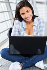 female college student with laptop computer