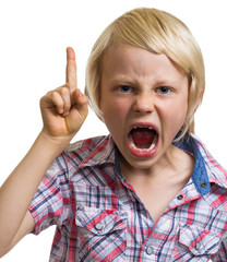 Angry shouting boy with finger raised on white