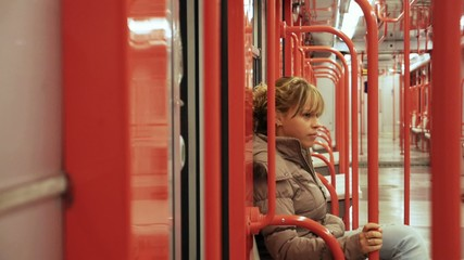 woman commuting, taking underground train