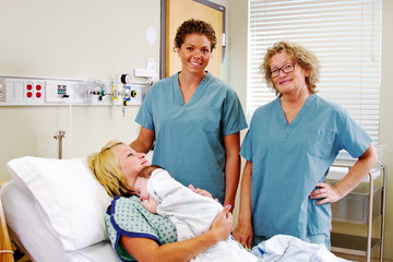 obstetric nurses with Mom and newborn