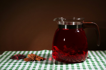 Jar of herbal tea on table, on dark background