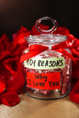 Romantic gift with red rose petals, close up