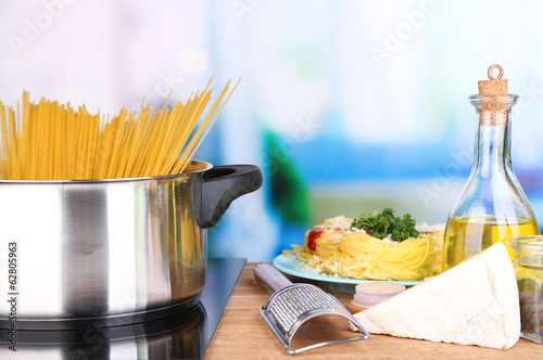 Process of preparing pasta. Composition with row spaghetti in