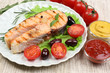 Tasty grilled salmon with vegetables, close up