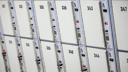 Lockers cabinets in a locker room.  lockers at a railway station