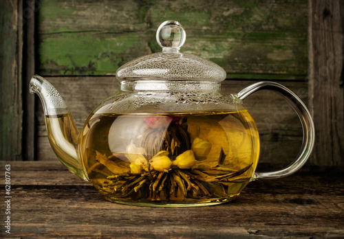 Blooming green tea in glass teapot
