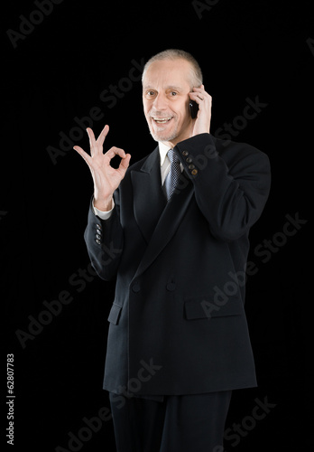 Smiling Okay Businessman on Phone