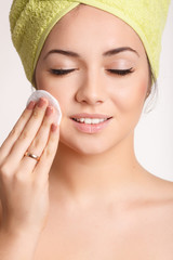 Beautiful woman skin care removing face makeup