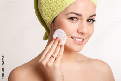 Beautiful woman skin care removing face makeup