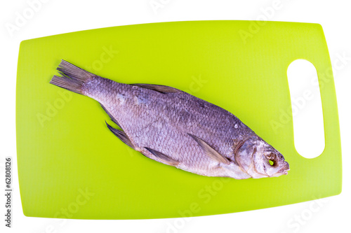 Cutting board in the kitchen and the dried bream