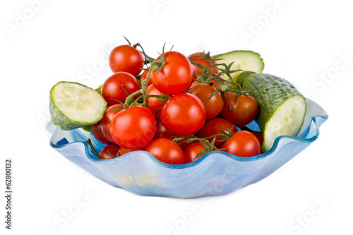 Tomatoes of cherry and slices of cucumbers