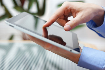 businessman using digital tablet, closeup