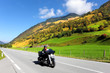 Постер, плакат: Among the hills motorcyclist rides
