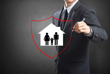 Shield protecting family and house, insurance concept