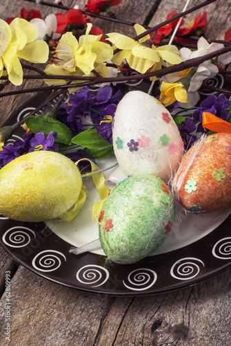 Easter composition with decorative eggs and flowers