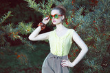 Trendy Fashion Model in Sunglasses Outdoors
