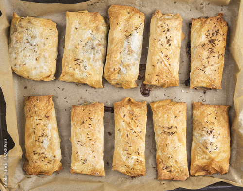 plate with baked puff pastry pies,top view