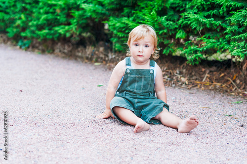 Summer portrait of adorable toddler boy